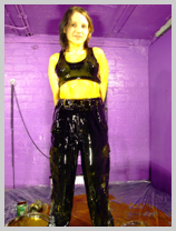 Felicity coats her black combats and sports bra in thick golden syrup featuring Felicity, the Serving Wench